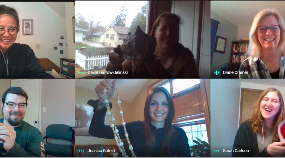 members from financial aid hold up items that remind them of seafood while over a video call